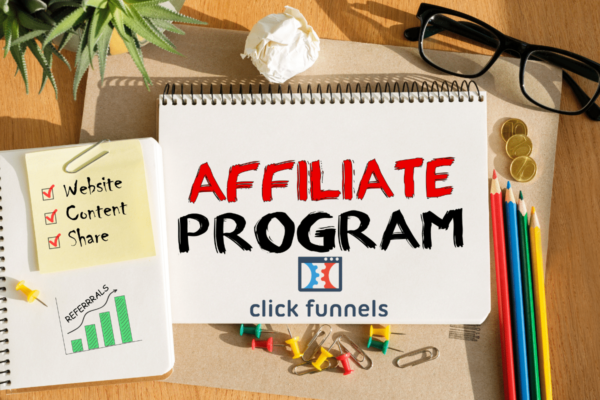 A notepad with ClickFunnels Affiliate Program review written on it