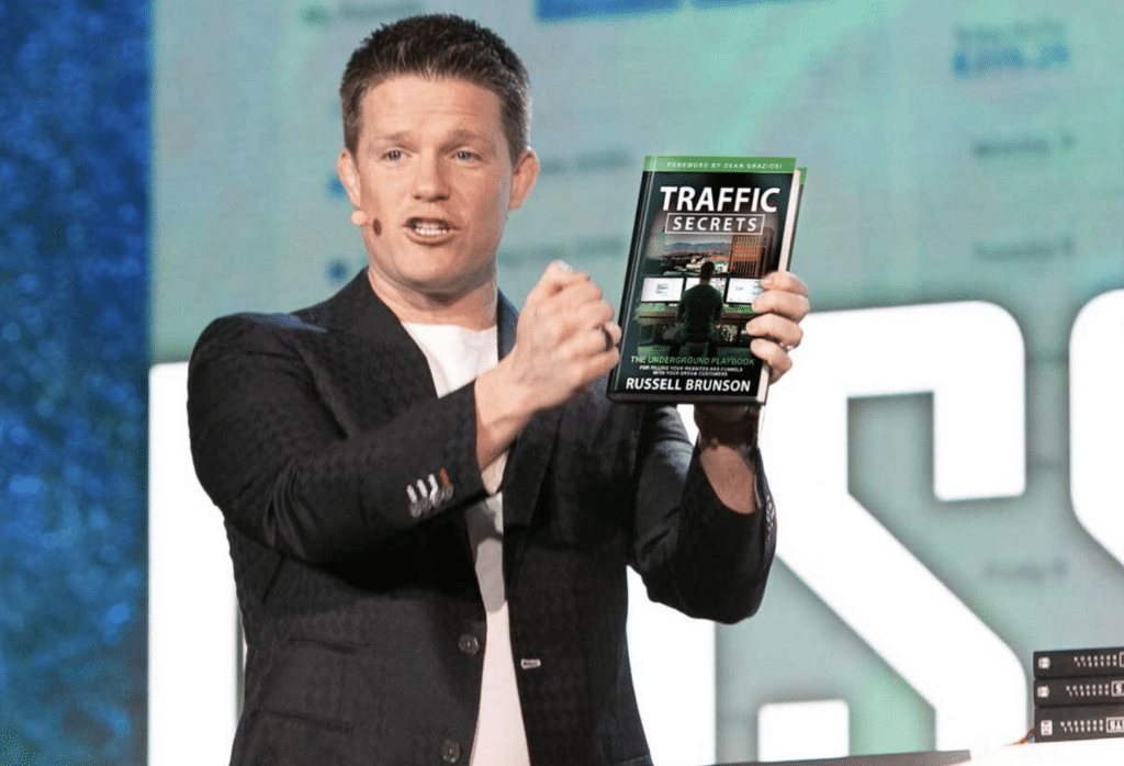 Russell Brunson Holding Traffic Secrets Book